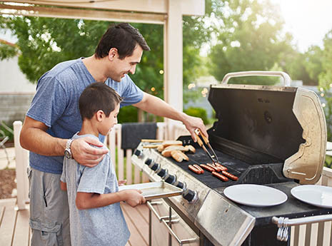 Father+and+son+at+the+grill front