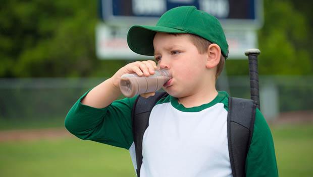 boy drinking chocolate milk