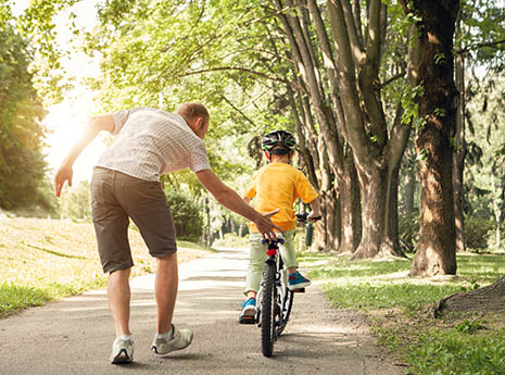 Dad+with+son+riding+a+bike front