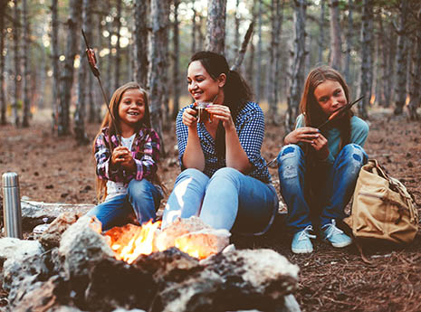 Family+eating+around+a+campfire front