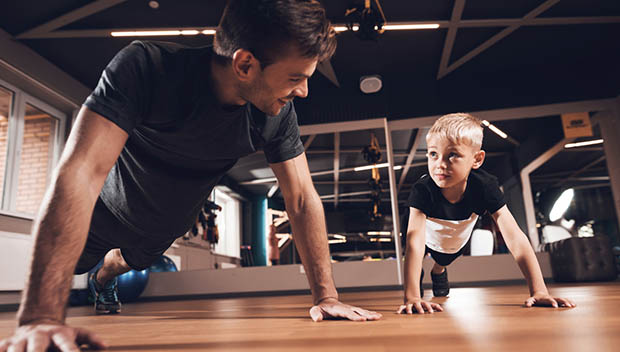 kid and dad working out