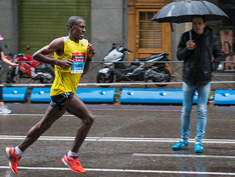 An elite runner finishing a marathon.