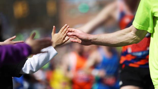 High-fiving runner
