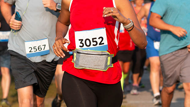 woman running with a fanny pack