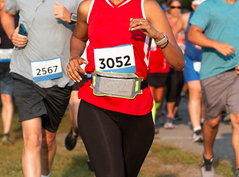 Woman+running+with+a+fanny+pack front