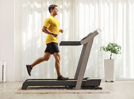 Man running on a treadmill front