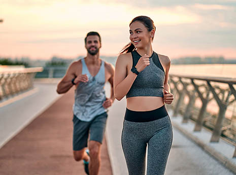Man+and+woman+running+at+sunrise front