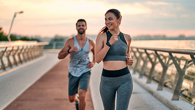 man-and-woman-running-at-sunrise