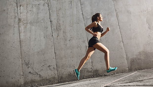 female runner on an incline