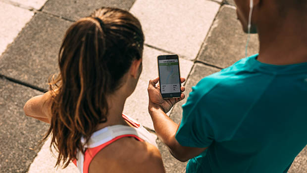 runners looking at a phone