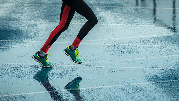 person running in the rain