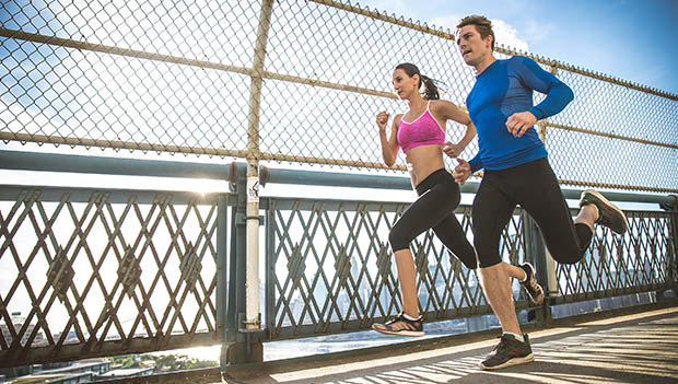 runners on a bridge